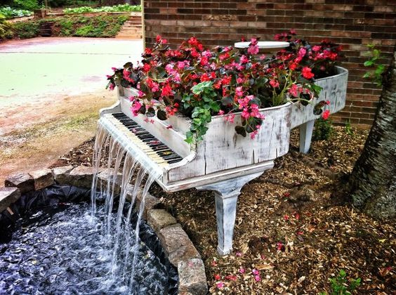 a creative planter using an old piano